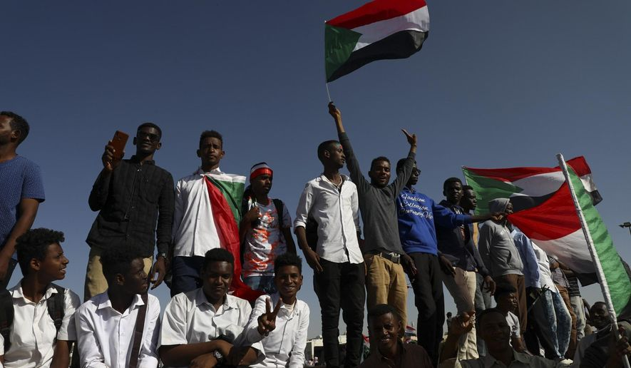 People gather as they celebrate first anniversary of mass protests that led to the ouster of former president and longtime autocrat Omar al-Bashir. in Khartoum, Sudan, Thursday, Nov. 19, 2019. (AP Photo)