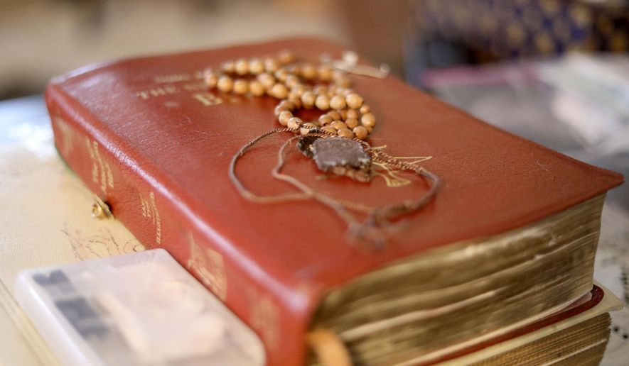 A rosary, scapular and Bible rest on a coffee table in Rancho Cucamonga, Calif., on Thursday, Sept. 26, 2019. (AP Photo/Wong Maye-E)  ** FILE **