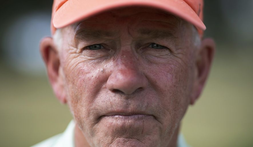 John Vai poses for a portrait on a golf course in The Villages, Fla., on Thursday, Nov. 21, 2019. Golf is part of his daily routine. Maintaining a schedule helps keep the dark memories at bay, he says. (AP Photo/Wong Maye-E)