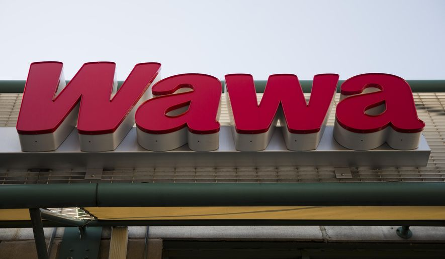 FILE - This April 2, 2015 file photo shows a Wawa convenience store in Philadelphia. The Wawa convenience store chain says a data breach may have collected debit and credit card information from thousands of customers, Thursday, Dec. 19, 2019. (AP Photo/Matt Rourke, File)