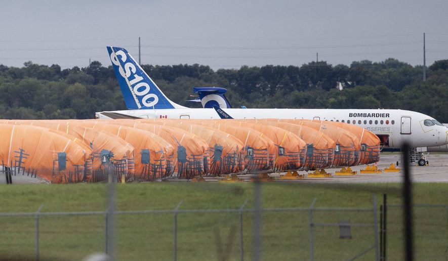 In this Oct. 3, 2019, file photo, completed Boeing 737 MAX fuselages, made at Spirit Aerosystems in Wichita, Kan., sit covered in tarps near the factory. Kansas Gov. Laura Kelly says that the state may have to help pay workers at aircraft parts maker Spirit AeroSystems to keep them on the assembly line if the Boeing 737 Max stays grounded much longer. (Travis Heying/The Wichita Eagle via AP File)