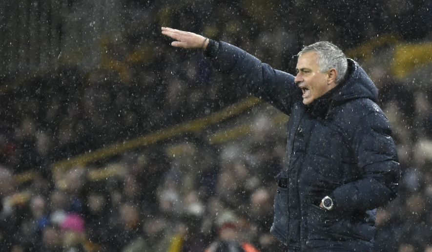 Tottenham's manager Jose Mourinho gives instructions from the side line during the English Premier League soccer match between Wolverhampton Wanderers and Tottenham Hotspur at the Molineux Stadium in Wolverhampton, England, Sunday, Dec.15, 2019. (AP Photo/Rui Vieira)
