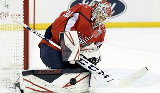 Washington Capitals goaltender Ilya Samsonov stops the puck during the second period of an NHL hockey game against the New Jersey Devils, Friday, Dec. 20, 2019, in Newark, N.J. (AP Photo/Bill Kostroun)