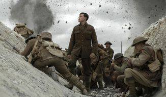 """Number 15: 1917   This image released by Universal Pictures shows George MacKay, center, in a scene from the 2019 film  """"1917,"""" directed by Sam Mendes. (François Duhamel/Universal Pictures via AP)"""