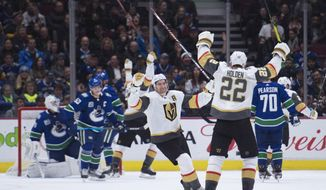Vegas Golden Knights defenseman Nick Holden (22) celebrates his goal against the Vancouver Canucks during the second period of an NHL hockey game Thursday, Dec. 19, 2019, in Vancouver, British Columbia. (Jonathan Hayward/The Canadian Press via AP)