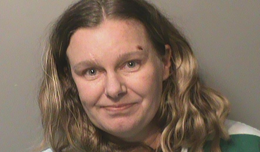 """This undated photo provided by the Polk County (Iowa) Jail shows Nicole Marie Poole Franklin. Clive, Iowa police on Thursday, Dec. 19, 2019, charged Franklin, of Des Moines with attempted murder. She's accused of purposely running down a 14-year-old girl who was walking along a sidewalk in a suburban neighborhood. Police say Franklin told investigators she hit the girl because she is """"a Mexican."""" The girl was seriously hurt but is recovering from her injuries. Franklin is being held in the Polk County Jail.(Polk County Jail via AP)"""