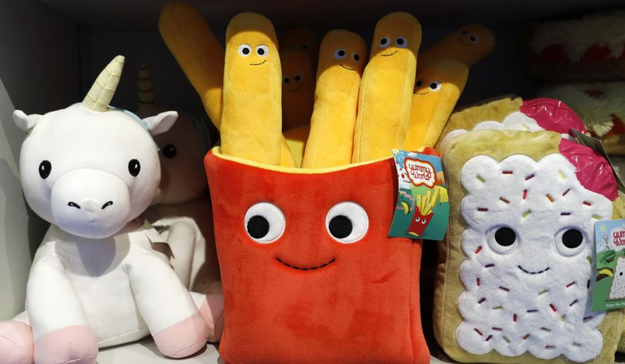 In this Nov. 21, 2019 photo, plush toys are displayed at a Camp store in New York. Camp, which was founded last year, not only sells toys but has also workshops and interactive areas for children. The concept is expanding to other locations and is the latest offering in experiential retail. (AP Photo/Mark Lennihan)