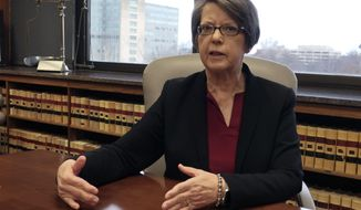 Kansas Supreme Court Chief Justice Marla Luckert answers questions during an interview with The Associated Press, Friday, Dec. 20, 2019, in the conference room where justices discuss cases, in Topeka, Kan. The Supreme Court is being asked in a lawsuit filed by six trial-court judges to declare that the state Legislature must boost funding on the court system. (AP Photo/John Hanna)