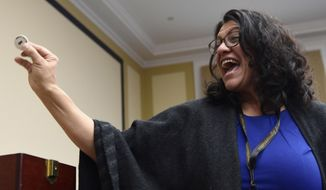 In this Monday, Dec. 9, 2019 file photo, Rep.-elect Rashida Tlaib, D-Mich., reacts after drawing her number during the Member-elect room lottery draw on Capitol Hill in Washington. Tlaib drew 8 out of 85, which determines the order in which she gets to select her new Capitol Hill office. Ms. Tlaib easily claimed the Democratic nomination for her House seat in the August 4, 2020 Democratic primary, easily defeating a challenge from a Detroit city councilwoman. (AP Photo/Susan Walsh)