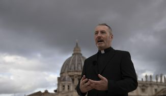 In this Monday, Dec. 9, 2019, file photo, Monsignor John Kennedy, the head of the Congregation for the Doctrine of the Faith discipline section, speaks during an interview on the terrace of the section's offices at the Vatican. (AP Photo/Alessandra Tarantino)