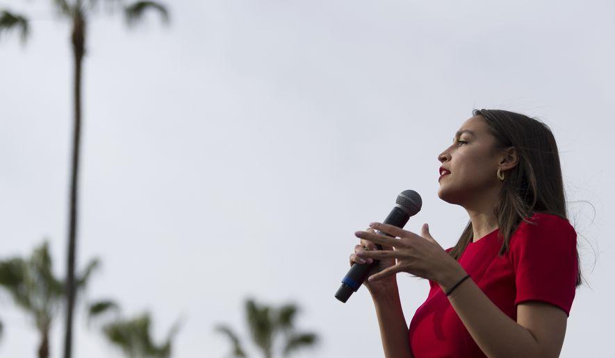 Rep. Alexandria Ocasio-Cortez, D-N.Y., speaks during a rally for Democratic presidential candidate Sen. Bernie Sanders, I-Vt., in Venice, Calif., Saturday, Dec. 21, 2019. (AP Photo/Kelvin Kuo)