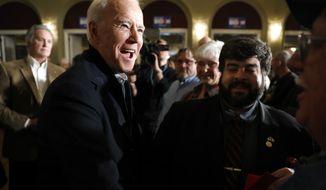 Democratic presidential candidate former Vice President Joe Biden greets audience members during a community event, Saturday, Dec. 21, 2019, in Ottumwa, Iowa. (AP Photo/Charlie Neibergall)