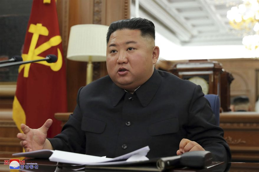 """In this photo provided Sunday, Dec. 22, 2019, by the North Korean government, North Korean leader Kim Jong Un speaks during a ruling party meeting, North Korea. North Korea said Sunday Kim has convened a key ruling party meeting to decide on steps to bolster the country's military capability. Independent journalists were not given access to cover the event depicted in this image distributed by the North Korean government. The content of this image is as provided and cannot be independently verified. Korean language watermark on image as provided by source reads: """"KCNA"""" which is the abbreviation for Korean Central News Agency. (Korean Central News Agency/Korea News Service via AP)"""