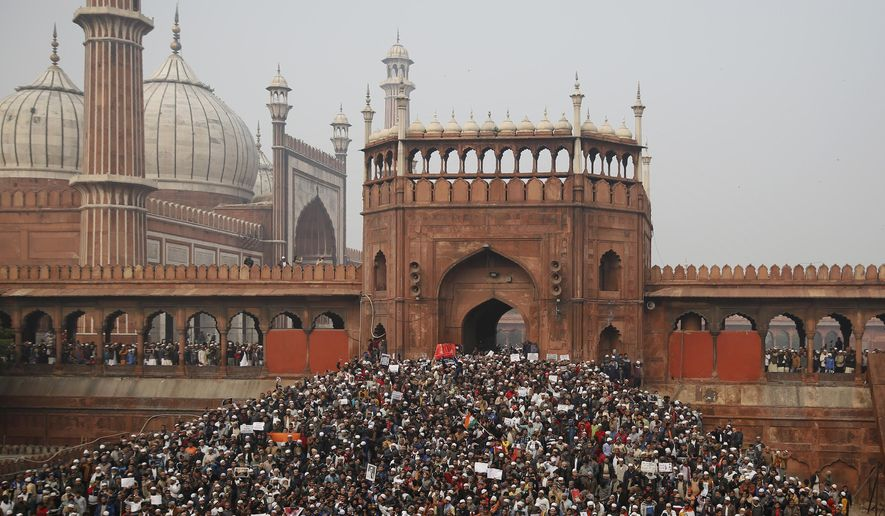Indians gather for a protest against the Citizenship Amendment Act after Friday prayers outside Jama Masjid in New Delhi, India, Friday, Dec. 20, 2019. Police banned public gatherings in parts of the Indian capital and other cities for a third day Friday and cut internet services to try to stop growing protests against a new citizenship law that have so far left eight people dead and more than 1,200 others detained. (AP Photo/Altaf Qadri)