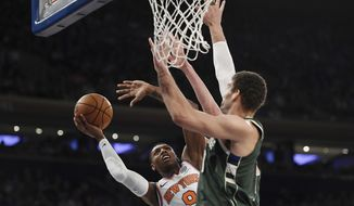 New York Knicks forward RJ Barrett (9) attempts a layup against Milwaukee Bucks center Brook Lopez (11) during the first half of an NBA basketball game in New York, Saturday, Dec. 21, 2019. (AP Photo/Sarah Stier)