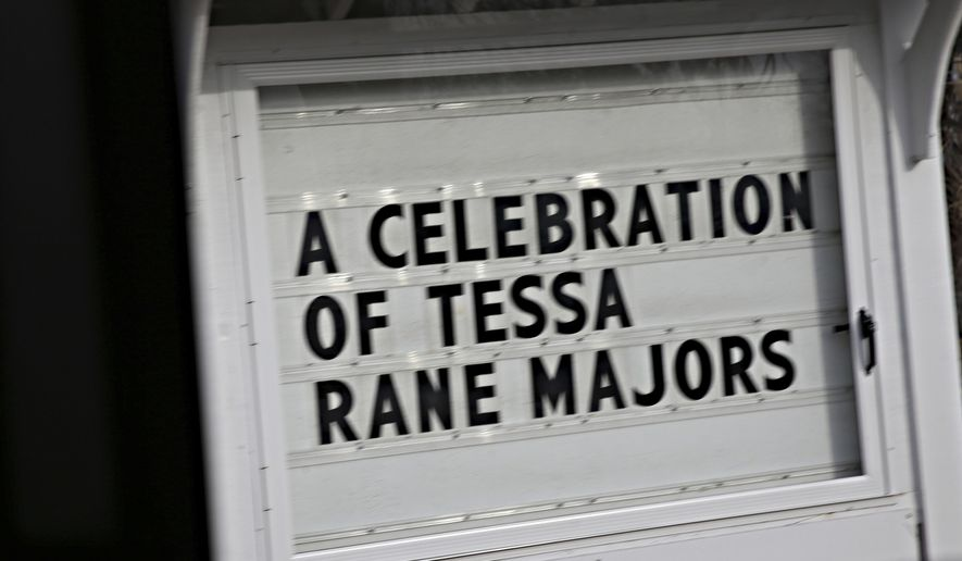 A sign for Tessa Majors Celebration of Life service is shown outside St. Anne's Belfield  in Charlottesville, Va., on Saturday, Dec. 21, 2019. Relatives and friends of the 18-year-old Barnard student who was killed in New York City on Dec. 11, will come together in her hometown to honor and remember her life. (Erin Edgerton/The Daily Progress via AP)