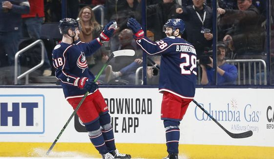 Columbus Blue Jackets' Oliver Bjorkstrand, right, of Denmark, celebrates his goal against the New Jersey Devils with teammate Pierre-Luc Dubois during the first period of an NHL hockey game Saturday, Dec. 21, 2019, in Columbus, Ohio. (AP Photo/Jay LaPrete)