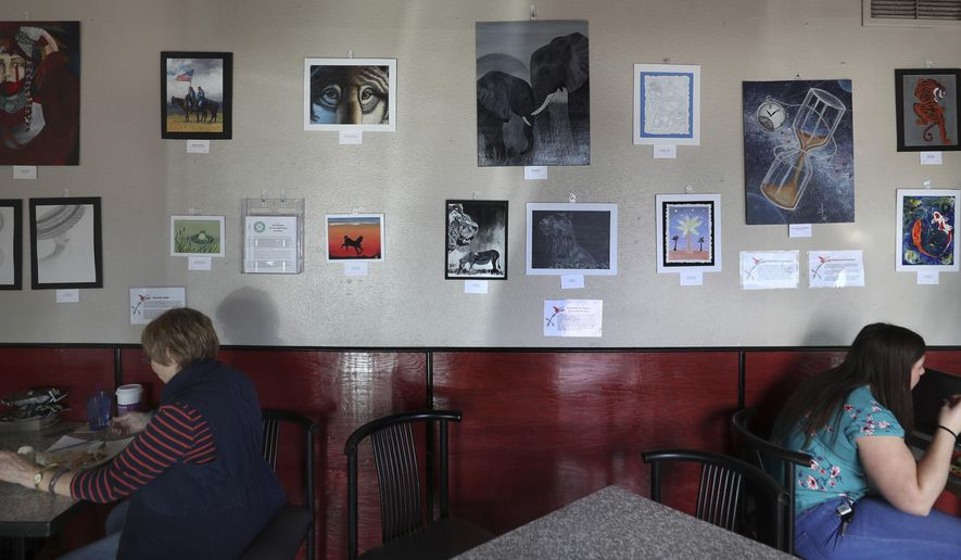The Women of Perryville Prison Art Show is currently on display on Dec. 12, 2019, at Coffee XChange, 6841 E. Camino Principal, Tucson, featuring work by prisoners or recently those recently released from incarceration. (Kelly Presnell/Arizona Daily Star via AP)