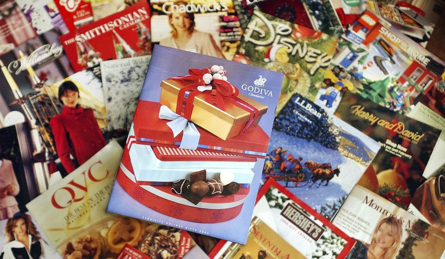 FILE - This Wednesday, Nov. 24, 2004 file photo shows a selection of holiday season catalogs in Portland, Maine. Catalogs, those glossy paper-and-ink offerings of outdoor apparel, kitchenware and fruit baskets, are not yet headed for the recycling bin of history. (AP Photo/Robert F. Bukaty, File)