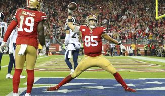 San Francisco 49ers tight end George Kittle (85) celebrates after scoring against the Los Angeles Rams during the second half of an NFL football game in Santa Clara, Calif., Saturday, Dec. 21, 2019. (AP Photo/John Hefti)