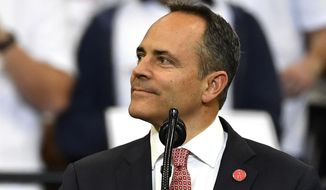 FILE - In this Nov. 4, 2019, file photo, Kentucky Gov. Matt Bevin looks out at the crowd during a campaign rally with President Donald Trump in Lexington, Ky. Bevin, who lost to Democrat Andy Beshear  in a close race, issued more than 400 pardons, including one for a convicted killer whose family raised campaign money for Bevin. This was one of the top stories in Kentucky in 2019.  (AP Photo/Timothy D. Easley, File)