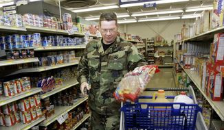 In this file photo, U.S. Air Force Tech. Sgt. Norman Long shops at the commissary at the Army's Charles E. Kelly Support Center in Oakdale, Pa., Aug. 2, 2005. (AP file photo) **FILE**