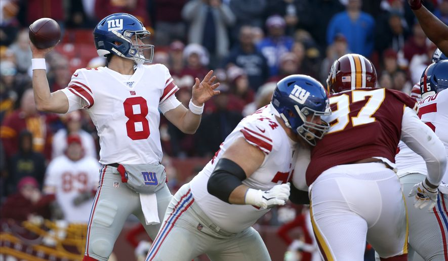 New York Giants quarterback Daniel Jones (8) throws a pass against the Washington Redskins during the first half of an NFL football game, Sunday, Dec. 22, 2019, in Landover, Md. (AP Photo/Alex Brandon)