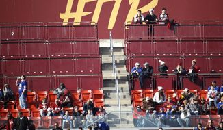 Empty standing room spots are seen at FedEx Field during the first half of an NFL football game between the Washington Redskins and the New York Giants, Sunday, Dec. 22, 2019, in Landover, Md. (AP Photo/Patrick Semansky) **FILE**