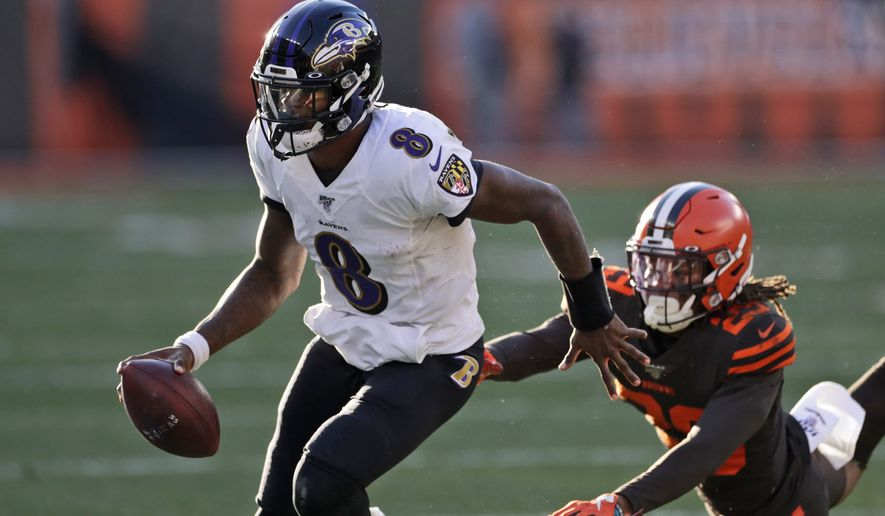 Baltimore Ravens quarterback Lamar Jackson (8) scrambles during the second half of an NFL football game against the Cleveland Browns, Sunday, Dec. 22, 2019, in Cleveland. (AP Photo/Ron Schwane) ** FILE **