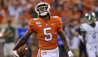 In this Sept. 21, 2019, file photo, Clemson's Tee Higgins reacts after scoring a touchdown during the first half of the team's NCAA college football game against Charlotte, in Clemson, S.C. Higgins was selected to The Associated Press All-Atlantic Coast Conference football team, Tuesday, Dec. 10, 2019. (AP Photo/Richard Shiro, File) **FILE**