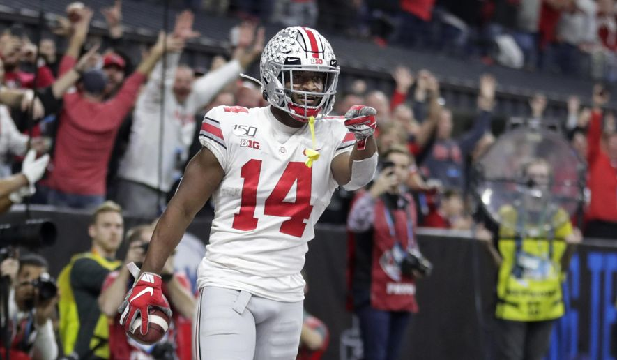 Ohio State wide receiver K.J. Hill (14) celebrates after making a touchdown catch during the second half of the team's Big Ten championship NCAA college football game against Wisconsin, Saturday, Dec. 7, 2019, in Indianapolis. (AP Photo/Michael Conroy) ** FILE **