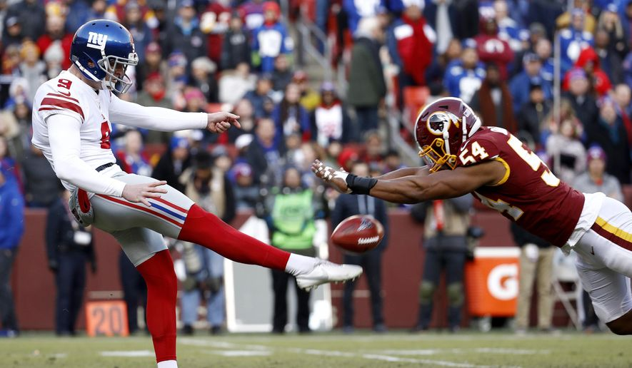 Washington Redskins linebacker Nate Orchard, right, blocks a punt attempt by New York Giants punter Riley Dixon during the second half of an NFL football game, Sunday, Dec. 22, 2019, in Landover, Md. (AP Photo/Patrick Semansky)  **FILE**