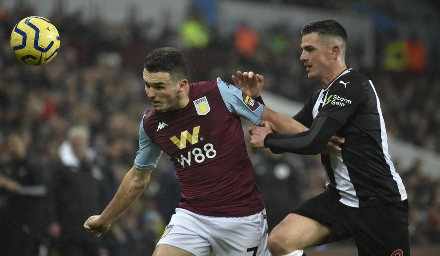Aston Villa's John McGinn, left, and Newcastle's Ciaran Clark challenge for the ball during the English Premier League soccer match between Aston Villa and Newcastle United at Villa Park in Birmingham, England, Monday, Nov. 25, 2019. (AP Photo/Rui Vieira)