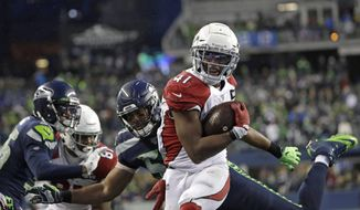 Arizona Cardinals running back Kenyan Drake gets past Seattle Seahawks outside linebacker K.J. Wright, center, to rush for a touchdown during the second half of an NFL football game, Sunday, Dec. 22, 2019, in Seattle. (AP Photo/Elaine Thompson)