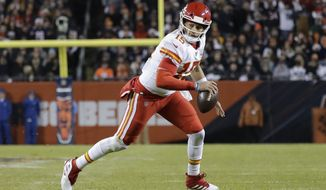 Kansas City Chiefs quarterback Patrick Mahomes (15) runs for a 12-yard touchdown against the Chicago Bears in the first half of an NFL football game in Chicago, Sunday, Dec. 22, 2019. (AP Photo/Nam Y. Huh)