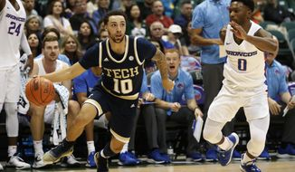Georgia Tech guard Jose Alvarado (10) tries to get around Boise State guard Marcus Dickinson (0) during the first half of an NCAA college basketball game Sunday, Dec. 22, 2019, in Honolulu. (AP Photo/Marco Garcia)