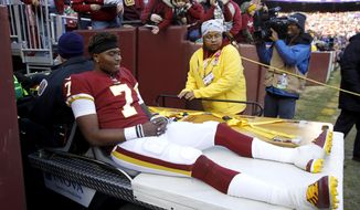 Washington Redskins quarterback Dwayne Haskins sits on cart while being taking off the field during the second half of an NFL football game against the New York Giants, Sunday, Dec. 22, 2019, in Landover, Md. (AP Photo/Patrick Semansky)