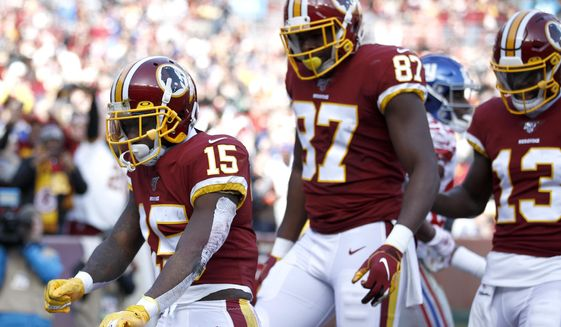 Washington Redskins wide receiver Steven Sims (15) celebrates after scoring on a touchdown pass from quarterback Dwayne Haskins, not visible, during the first half of an NFL football game against the New York Giants, Sunday, Dec. 22, 2019, in Landover, Md. (AP Photo/Patrick Semansky) ** FILE **