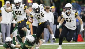 Appalachian State running back Marcus Williams Jr. (26) carries the ball against UAB during the first half of the New Orleans Bowl NCAA college football game in New Orleans, Saturday, Dec. 21, 2019. (AP Photo/Brett Duke)