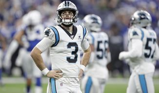Carolina Panthers quarterback Will Grier (3) looks at a replay during the second half of an NFL football game against the Indianapolis Colts, Sunday, Dec. 22, 2019, in Indianapolis. (AP Photo/Michael Conroy)