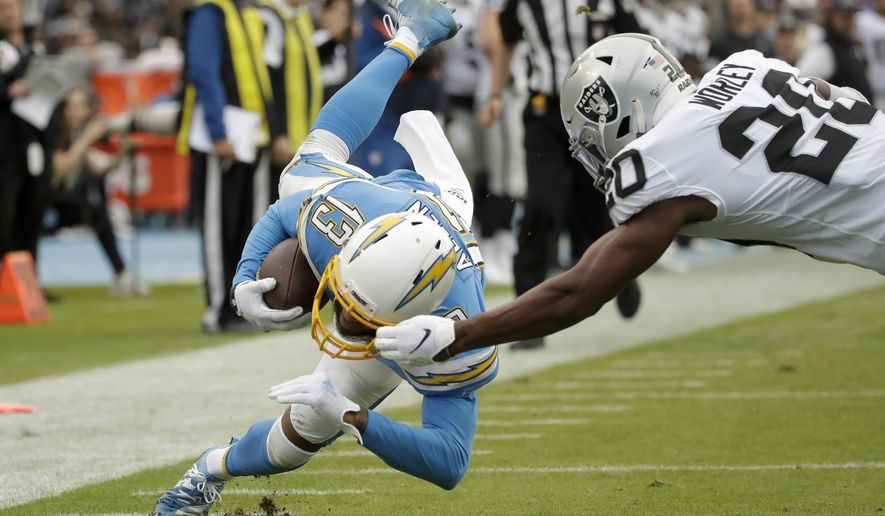 Oakland Raiders cornerback Daryl Worley, right, tackles Los Angeles Chargers wide receiver Keenan Allen short of the goal line during the second half of an NFL football game Sunday, Dec. 22, 2019, in Carson, Calif. (AP Photo/Marcio Jose Sanchez)