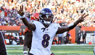 Baltimore Ravens quarterback Lamar Jackson celebrates a 12-yard touchdown pass to running back Mark Ingram during the second half of an NFL football game against the Cleveland Browns, Sunday, Dec. 22, 2019, in Cleveland. (AP Photo/Ron Schwane)