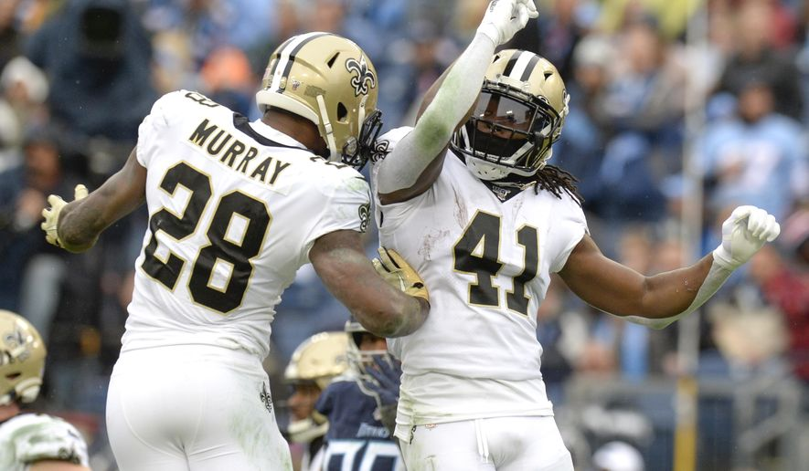 New Orleans Saints running back Alvin Kamara (41) celebrates with running back Latavius Murray (28) after Kamara scored a touchdown against the Tennessee Titans in the second half of an NFL football game Sunday, Dec. 22, 2019, in Nashville, Tenn. (AP Photo/Mark Zaleski)