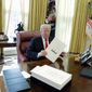 The Trump administration and its supporters said that the consistently good economic news resulted large in part from the 2017 tax cuts. Mr. Trump is planning to introduce an additional tax-cut bill to Congress prior to the April 15 Tax Day. (Associated Press) **FILE**