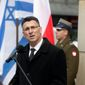 Israeli Education Minister Gideon Saar speaks during an unveiling ceremony for a plaque honoring Pawel Frenkel, a leader of the 1943 Warsaw Ghetto Uprising, in Warsaw, Poland, on Tuesday March 20, 2012. Frenkel was a senior commander of the Jewish Military Union, an underground resistance group that opposed the Nazi occupation of Poland during World War II. He died in the uprising. (AP Photo/Czarek Sokolowski)