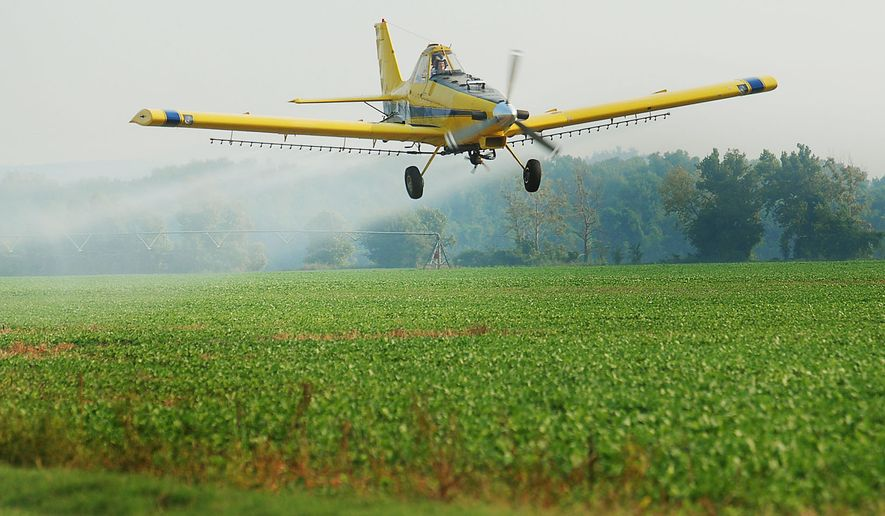 Paul Gould, owner of AgraTech, Inc. in Webbers Falls, Okla., sprays soybean fields with water using one of his crop duster airplanes, Thursday, Aug. 16, 2007. Gould, 49, says he can do his job for another 10 or 15 years, health permitting, buying time for him to find a successor to take over his business. Recruiting the next generation of crop dusting pilots has proven difficult for many mom-and-pop business owners, and some worry that lucrative careers with the airlines, better technology and genetically engineered crops are contributing to a decline in the industry. (AP Photo/Brandi Simons)