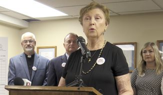 """in this June 26, 2019, photo, Barbara Listing, president of Right to Life of Michigan, joins other anti-abortion advocates to officially launch a ballot drive to restrict a common second-trimester abortion procedure opponents call """"dismemberment,"""" and known medically as dilation and evacuation, during a news conference in Lansing, Mich. A ballot group planned Monday, Dec. 23, 2019, to submit petitions to prohibit a second-trimester abortion procedure in Michigan, a key step toward placing the veto-proof legislation before the Republican-controlled Legislature. (AP Photo/David Eggert) **FILE**"""