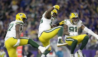Green Bay Packers' Kenny Clark, left, Za'Darius Smith and Preston Smith, right, celebrate after a sack during the first half of the team's NFL football game against the Minnesota Vikings, Monday, Dec. 23, 2019, in Minneapolis. (AP Photo/Andy Clayton-King)