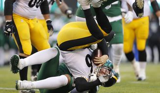 Pittsburgh Steelers quarterback Devlin Hodges (6) is stopped by New York Jets defensive end Kyle Phillips in the second half of an NFL football game, Sunday, Dec. 22, 2019, in East Rutherford, N.J. (AP Photo/Adam Hunger)