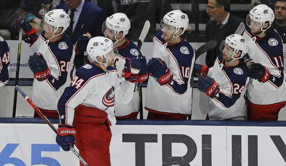 Columbus Blue Jackets' Vladislav Gavrikov (44) celebrates with teammates after scoring a goal during the third period of an NHL hockey game against the New York Islanders Monday, Dec. 23, 2019, in Uniondale, N.Y. The Blue Jackets won 3-2. (AP Photo/Frank Franklin II)